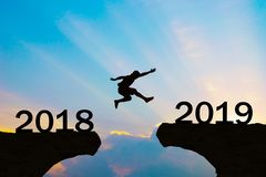 happy-new-year-2019-men-jump-over-silhouette-mountains-127218134